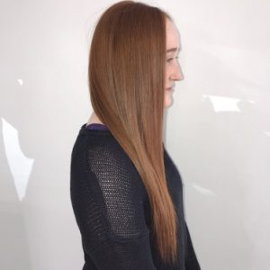 woman standing sideways with long hair
