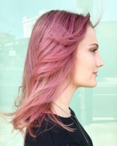 woman smiling with pink hairstyle - small image