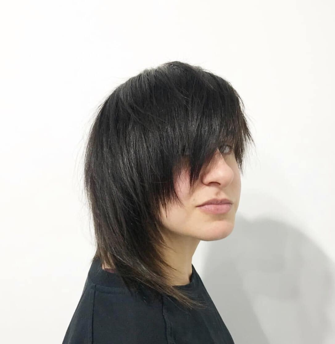 woman with short hair and long fringe