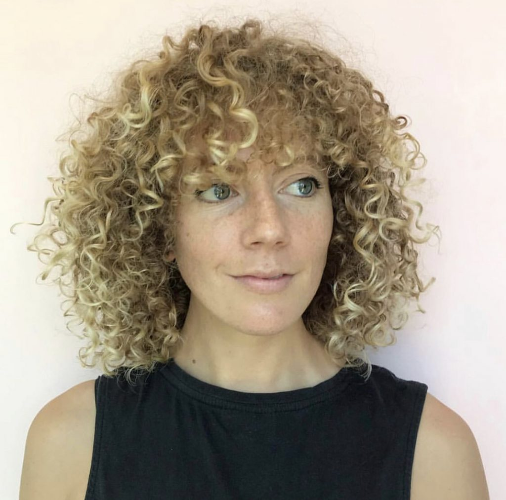 woman with curly blonde hair