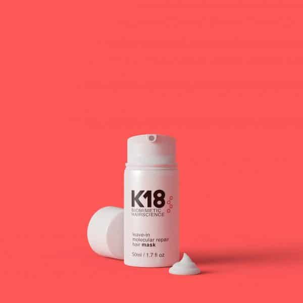 K18 leave-in molecular repair hair mask on a red background