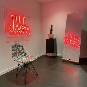 delilah hair studio with a red neon sign board